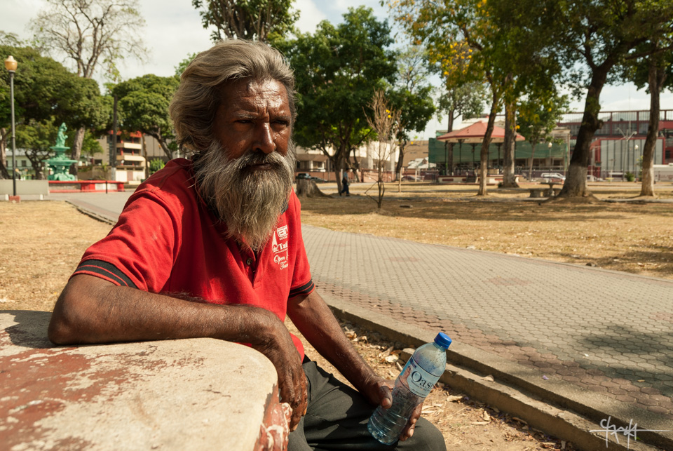 Image Caption: Portrait of a bearded man on Woodford Square, Port of Spain, Trinidad. May 23rd, 2015.—Click to read this article.