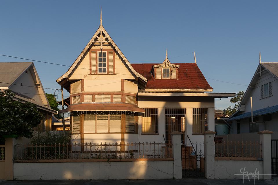 A house on Scott-Bushe Street, Port of Spain, sits in mottled Light. October 7th, 2015.