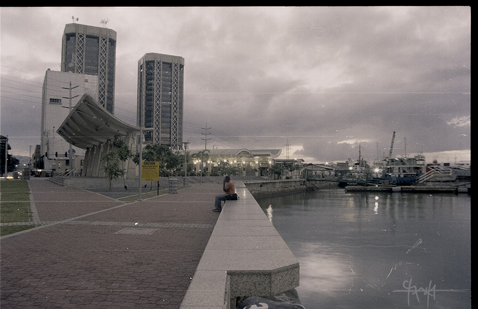 View overlooking the ferry port and the Breakfast Shed of Port of Spain, with the twin towers of Central Bank of Trinidad and Tobago in the background. January 2011.