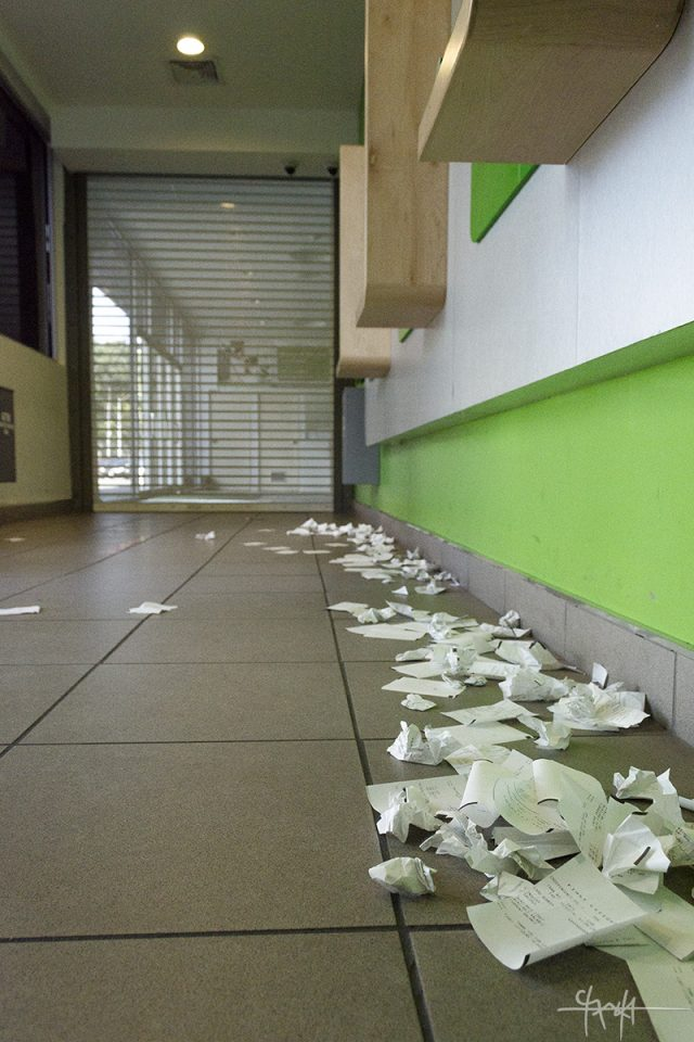 Banking machine receipts litter the floor of the Independence Square branch of First Citizen's Bank. 30th July, 2016. (Shaun Rambaran / Forge Business Imagery)