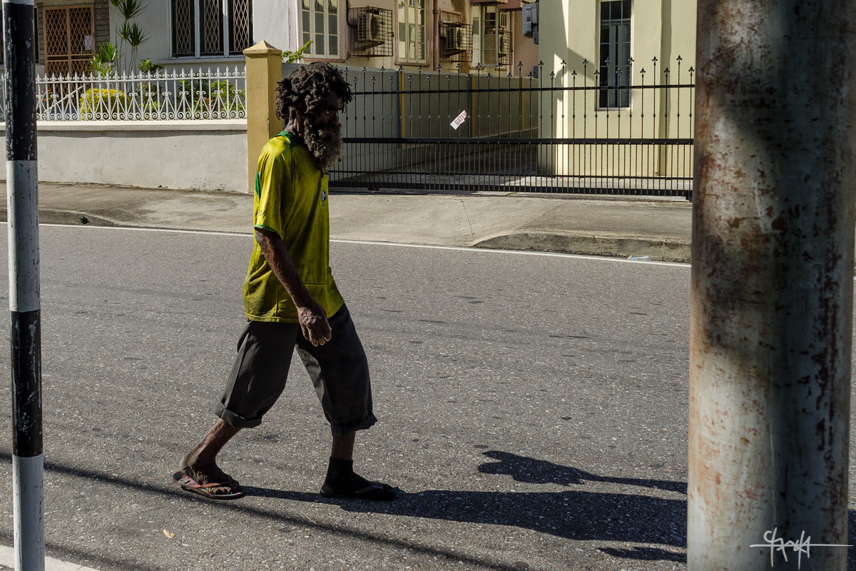 A dishevelled man walks along Duke Street, Port of Spain. 30th July, 2016. (Shaun Rambaran / Forge Business Imagery)