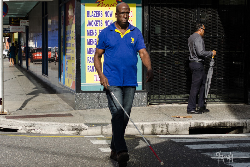Image Caption: A visually-impaired man crosses the street. 5th October, 2016.—Click to read this article.