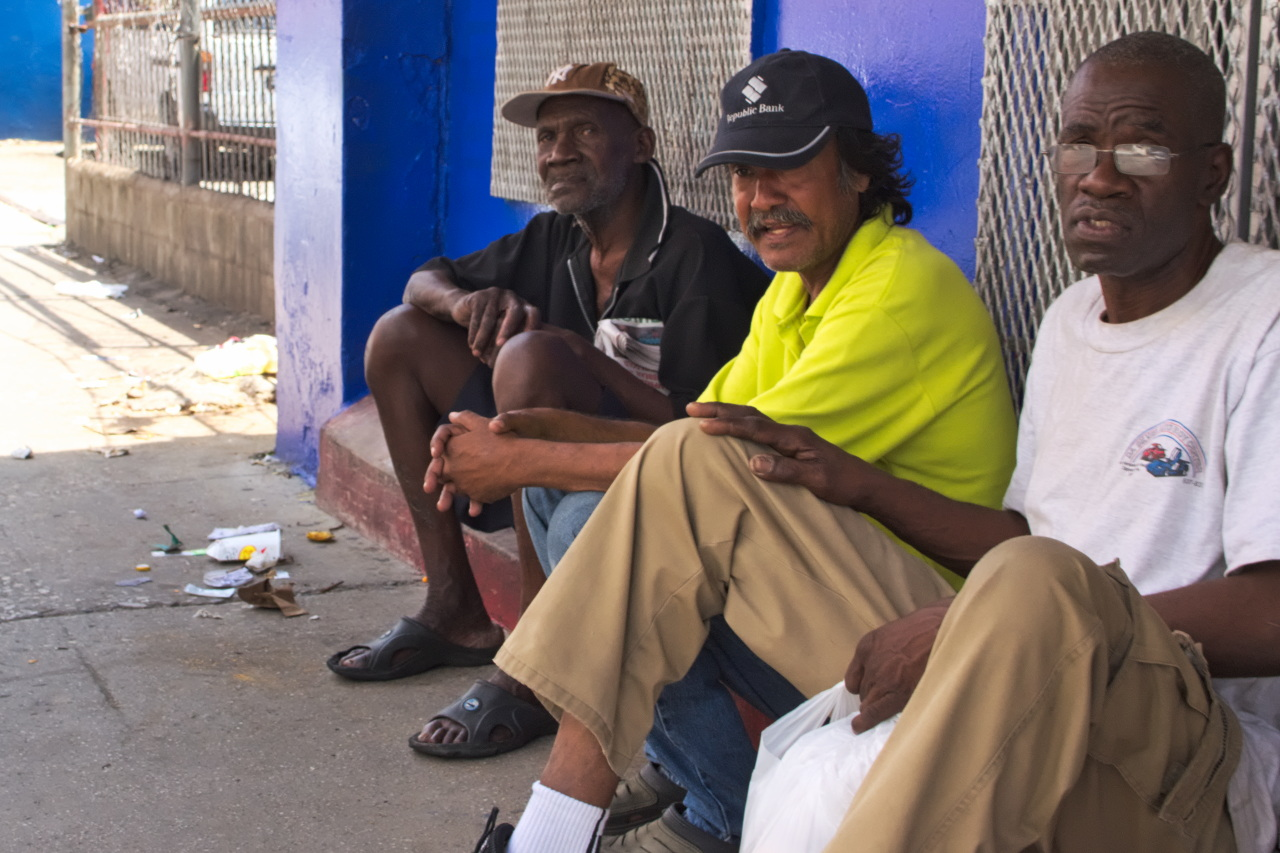 Image Caption: Three men sit and chat near the top of Charlotte Street, Port of Spain, Trinidad. 3rd September, 2017.—Click to read this article.