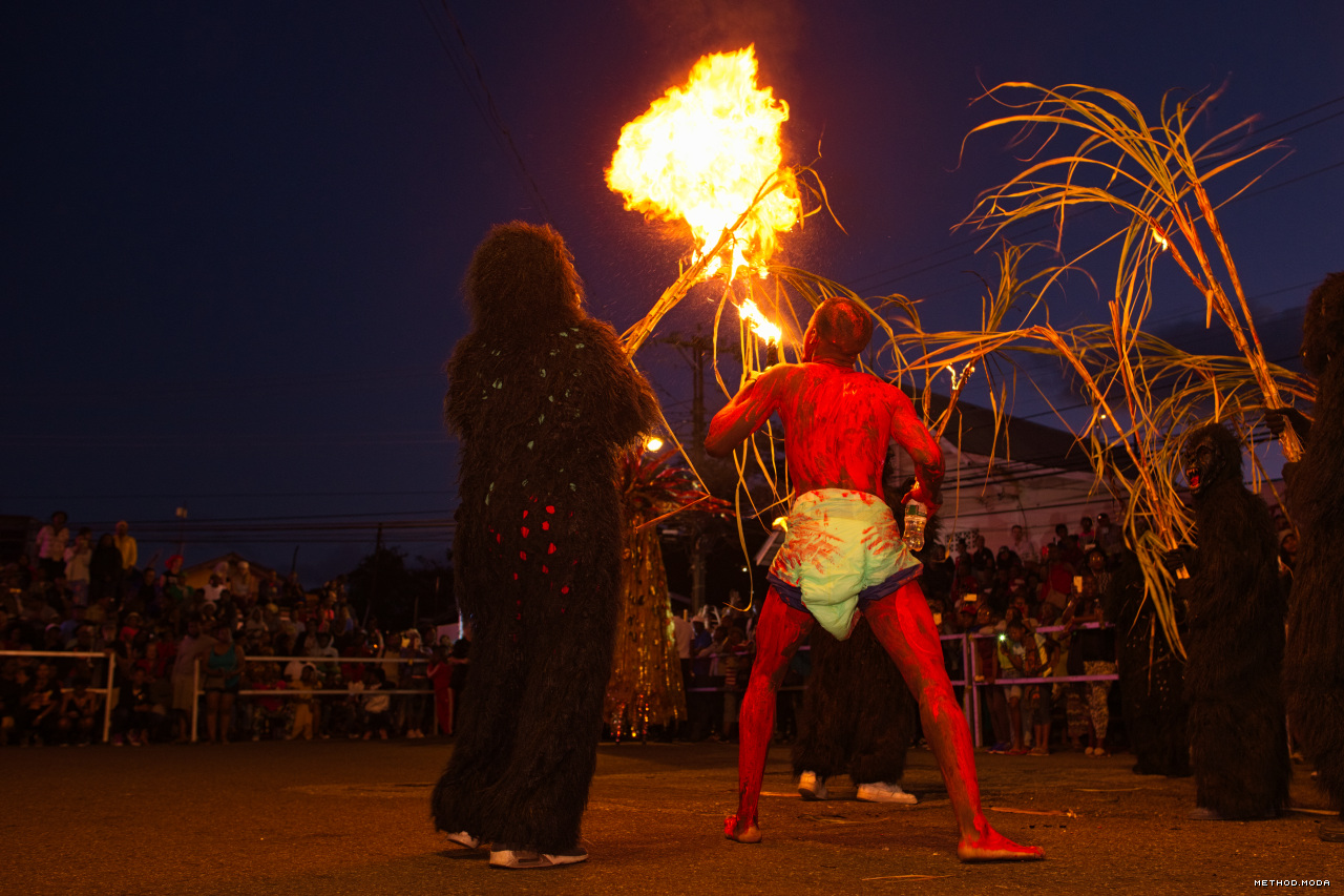 Image Caption: A firebreathing jab ignites stalks at Canboulay. 1st March, 2019.—Click to read this article.