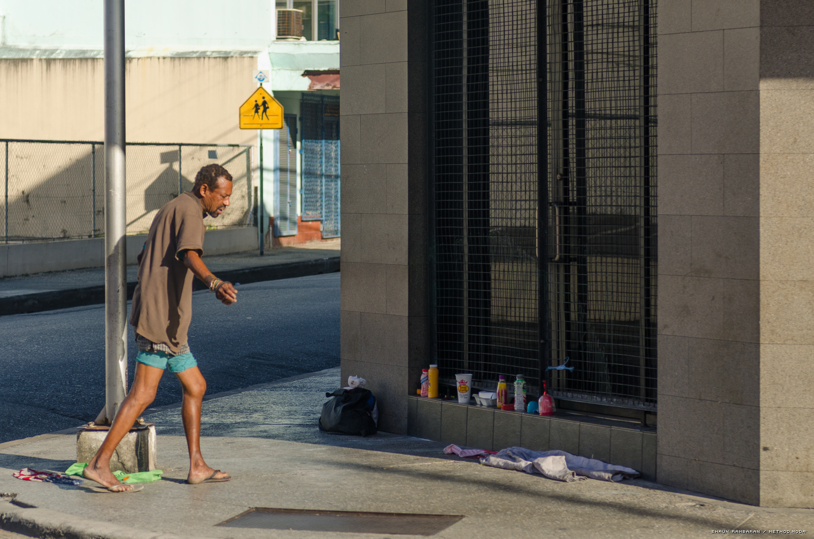 Image Caption: A homeless man customarily seen along Park Street (and environs), Port of Spain.  14th December, 2014.—Click to read this article.